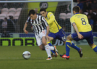 Paul McGowan getting away from Paul Heffernan in the St Mirren v Kilmarnock Clydesdale Bank Scottish Premier League match played at St Mirren Park, Paisley on 2.1.13.