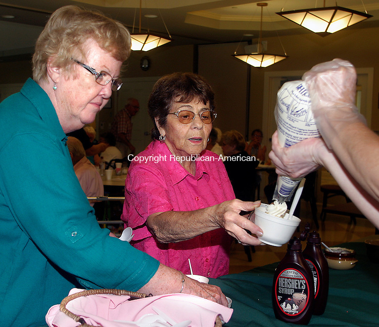 WOODBURY, CT.-19 AUGUST 2009-08199DA05- (FOR COUNTRY LIFE)-Mary Meeker, right, has whipped cream added to her ice cream by Carey St. Martain as Sheila Spencer, left, looks on during the Woodbury Senior Center's last cookout Wednesday.<br />  Darlene Douty Republican-American