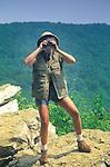 Funny hiker with binoculars on Hawk Mountain, PA. Berks County