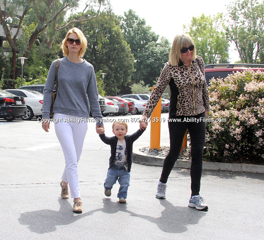 March 25d 2013   <br /> <br /> <br /> January Jones holding hands walking with her baby Xander with her mom in Los Angeles . <br /> White jeans leopard cheetah print shirt <br /> <br /> <br /> AbilityFilms@yahoo.com<br /> 805 427 3519 <br /> www.AbilityFilms.com
