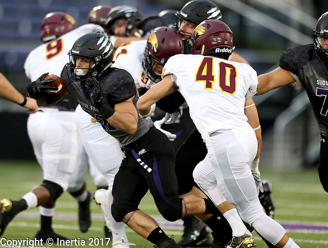 SIOUX FALLS, SD - SEPTEMBER 23: Max Mickey #22 from the University of Sioux Falls looks looks for running room past Trevor Long, Jr. #40 from Minnesota Crookston in the first half of their game Saturday night at Bob Young Field in Sioux Falls. (Photo by Dave Eggen/Inertia)