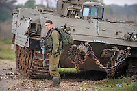 An Israeli soldier beside a tank on the Israel-Gaza border. Israeli forces began an air offensive against Hamas in Gaza on 27/12/2008, which quickly escalated into an offensive by land, sea and air, in retaliation against Palestinian rockets fired into Israel. After eight days of bombardment, leaving over 400 Palestinians and four Israelis dead, Israeli tanks entered Gaza on 04/01/2009...