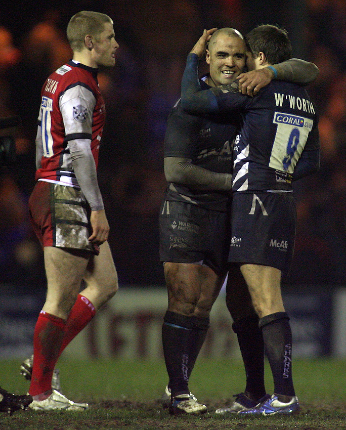 Photo: Paul Thomas..Sale Sharks v Gloucester Rugby. Guinness Premiership. 06/01/2007...Richard Wigglesworth (R) of Sale celebrates their last minute win over Gloucester with team-mate Sililo Martens while Iain Balshaw show his dejected. Wigglesworth set up the win with his penalty kick.