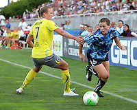 Jill Gilbeau #3 of the Washington Freedom, playing in a special camouflage uniform cuts past Sara Larrson #7 of the Philadelphia Independence during a WPS match on military appreciation night at the Maryland Soccerplex in Boyds, Maryland on May 30 2010. Freedom won 2-1.