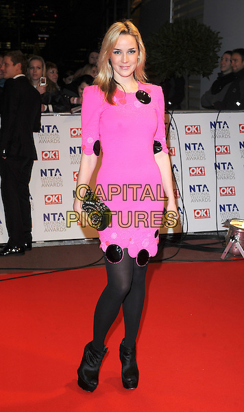 ALICE COULTHARD.Arrivals at the 15th National Television Awards held at the O2 Arena, London, England. .January 20th, 2010 .NTA NTAs full length black dress pink neon fluorescent tights clutch bag ankle boots shoes .CAP/BEL.©Tom Belcher/Capital Pictures