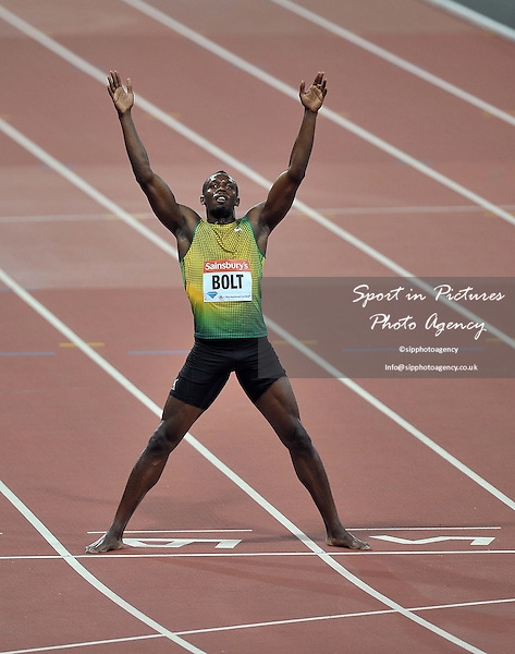 Ussain Bolt (JAM) celebrates. Sainsburys Anniversary Games. IAAF Diamond League. Olympic Stadium. Queen Elizabeth Olympic Park. Stratford. London. UK. 26/07/2013. MANDATORY Credit Garry Bowden/SIPPA - NO UNAUTHORISED USE - 07837 394578