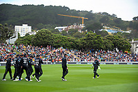 The Black Caps walk out to field during the One Day International cricket match between the NZ Black Caps and Pakistan at the Basin Reserve in Wellington, New Zealand on Saturday, 6 January 2018. Photo: Dave Lintott / lintottphoto.co.nz