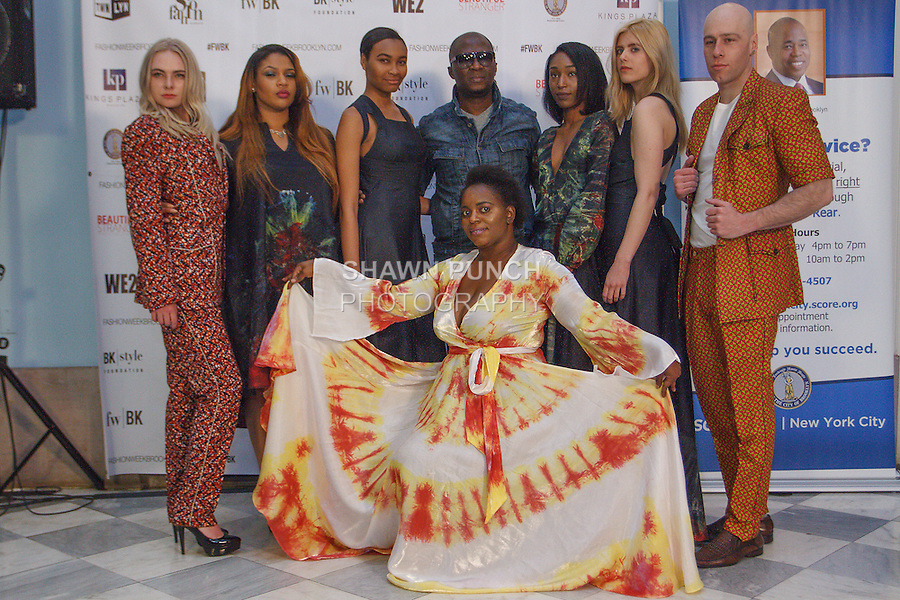 Fashion designer Raif poses with models at his Raif Atelier Spring Summer 2016 presentation, during the Fashion Week Brooklyn Fall Winter 2016 Press Event in Brooklyn Borough Hall at 209 Joralemon Street, Brooklyn,  New York, on April 26, 2016.