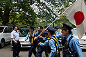 June 5, 2011- A Right wing counter- demonstrator carrying a flag is prevented from getting at left wing Anti nuclear demonstrators by Police at Hibiya Public Hall in Tokyo, Japan. Around 200 left-wing protesters marched in front of  TEPCO's office in Shinbashi chanting 'No Nukes, No more Hiroshima, No more Nagasaki and no more lies'. A group of about 20 right wing counter demonstrators and seven sound vans were blocked from reaching the left wing by Tokyo Police. (Photo by B.Meyer-Kenny/2.0 Images)