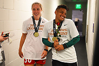 Orlando, FL - Saturday October 14, 2017:  Celeste Boureille, Adrianna Franch and the Portland Thorns FC celebrate their National Women's Soccer League (NWSL) Championship win by defeating North Carolina Courage 1-0 during the NWSL Championship match between the North Carolina Courage and the Portland Thorns FC at Orlando City Stadium.