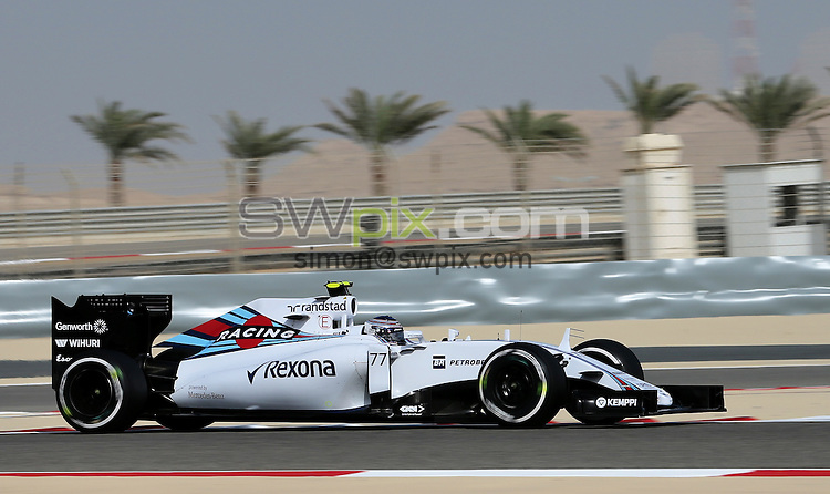 PICTURE BY MARK GREEN/SWPIX.COM - Formula 1, Bahrain International Circuit, 17-19th April 2015 <br /> Valtteri Bottas drives his Williams  in the desert with a backdrop of palm trees