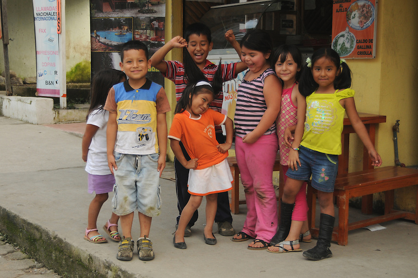 Children on main street in the small village of Mindo, Ecuador