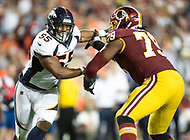 Landover, MD - August 24, 2018: Denver Broncos linebacker Bradley Chubb (55) and Washington Redskins offensive tackle Ty Nsekhe (79) battle in the trenches during preseason game between the Denver Broncos and Washington Redskins at FedEx Field in Landover, MD. The Broncos defeat the Redskins 29-17. (Photo by Phillip Peters/Media Images International)