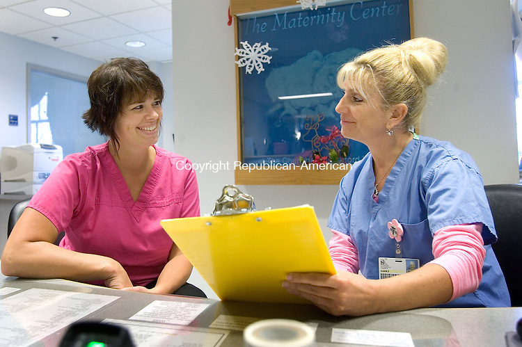 TORRINGTON CT. 26 December 2014-122614SV03-From left, Vicki Preato, PCT, and Carey Hock, RN, work in the Maternity Center at Charlotte Hungerford Hospital in Torrington Friday. <br /> Steven Valenti Republican-American