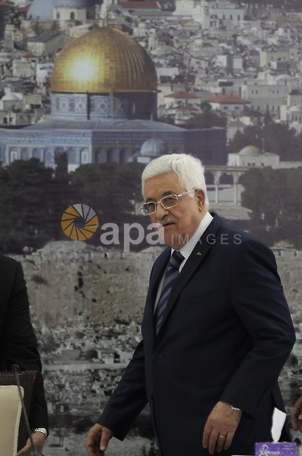"Palestinian President Mahmoud Abbas speaks during a meeting with members of the Palestinian leadership on November 8, 2014 in the West Bank city of Ramallah. The European Union's new foreign affairs chief Federica Mogherini called for the establishment of a Palestinian state, saying during a visit to Gaza that the world ""cannot afford"" another war in Gaza. Photo by Shadi Hatem"