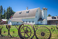 The Dahmen barn was built in 1935 and operated as a commercial dairy operation until 1953. Steve Dahmen has made a public display of his artistic skills by building the surrounding wheel fence over a 30 year period, which now features of 1000 wheels of all kinds.  The barn was donated to the community in 2004, restored and turned into an art center.