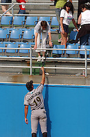 Outfielder Jeff Francoeur of the Myrtle Beach Pelicans, Class A affiliate of the Atlanta Braves, gives a bat to the mother of a child hit by a foul ball, taken at Pfitzner Stadium, Woodbridge, Va., June 6, 2004. (Tom Priddy/Four Seam Images)