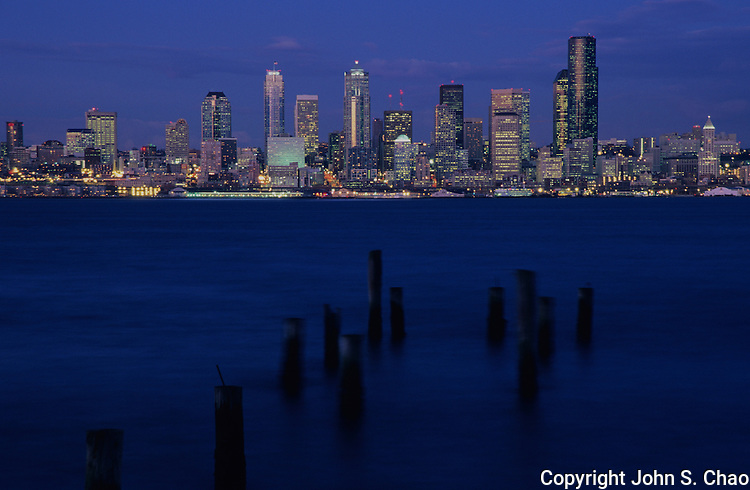 Nighttime view of the Seattle skyline across Elliott Bay from Alki, Seattle, Washington State.