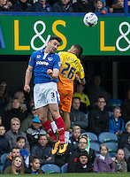 Enda Stevens of Portsmouth & Jerell Sellars (Loanee from Aston Villa) of Wycombe Wanderers go for the ball during the Sky Bet League 2 match between Portsmouth and Wycombe Wanderers at Fratton Park, Portsmouth, England on 23 April 2016. Photo by Andy Rowland.