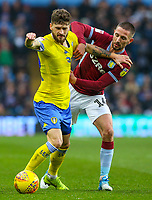 Leeds United's Mateusz Klich takes on Aston Villa's Conor Hourihane<br /> <br /> Photographer Alex Dodd/CameraSport<br /> <br /> The EFL Sky Bet Championship - Aston Villa v Leeds United - Sunday 23rd December 2018 - Villa Park - Birmingham<br /> <br /> World Copyright &copy; 2018 CameraSport. All rights reserved. 43 Linden Ave. Countesthorpe. Leicester. England. LE8 5PG - Tel: +44 (0) 116 277 4147 - admin@camerasport.com - www.camerasport.com
