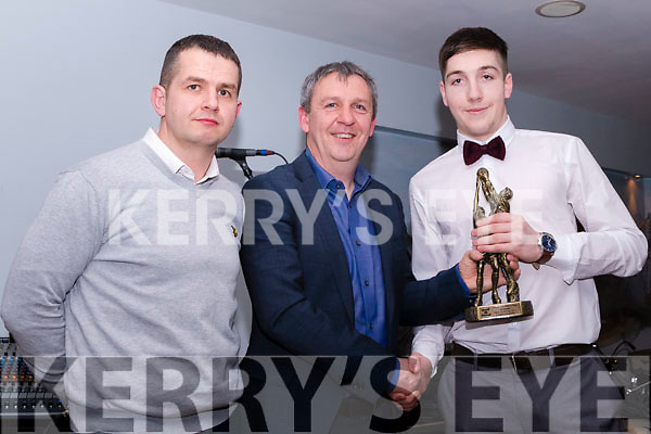 Darren Houlihan is presented the award for Cromane GAA's Player of the Year by Kerry Minor Manager, Peter Keane pictured here with Senior Team trainer, Gavin O'Connor
