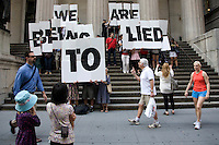 "Activists gather as part of a Flash Mob on the steps of Federal Hall in New York City to tell Wall Street that ""America's Not Broke"" on 06 June 2011.  The action was planned after video emerged of the Fox News ticker getting hacked earlier in the week."