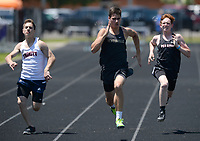 NWA Democrat-Gazette/ANDY SHUPE<br /> Brock McRae of Bentonville's (center) leads Zach Woods of Pea Ridge (right) and Evan Miller of Trinity Christian Wednesday, May 15, 2019, while competing in the 100-meter portion of the state decathlon championship at Ramay Junior High School. Visit nwadg.com/photos to see more photographs from the meet.