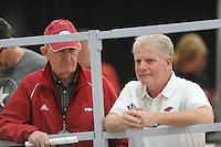 NWA Democrat-Gazette/ANDY SHUPE<br /> Former Arkansas coach John McDonnell (left) and current coach Chris Bucknam speak Saturday, Feb. 11, 2017, during the Tyson Invitational in the Randal Tyson Track Center in Fayetteville. Visit nwadg.com/photos to see more photographs from the meet.
