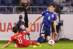 Haraguchi Genki of Japan (R) fights for the ball with Nguyen Trong Hoang of Vietnam (L) during the AFC Asian Cup UAE 2019 Quarter Finals match between Vietnam (VIE) and Japan (JPN) at Al Maktoum Stadium on 24 January 2018 in Dubai, United Arab Emirates. Photo by Marcio Rodrigo Machado / Power Sport Images
