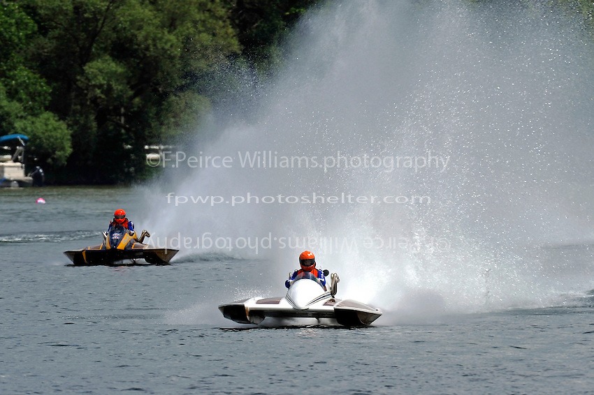 "Bryan McGregor, F-100 ""Miss Bonnie"" (1982 6 Litre class Staudaucher cabover hydroplane) and Philip Mitchell, F-726 ""Flying Tiger"", 1978 Gibbs 5 Litre class cabover hydroplane"