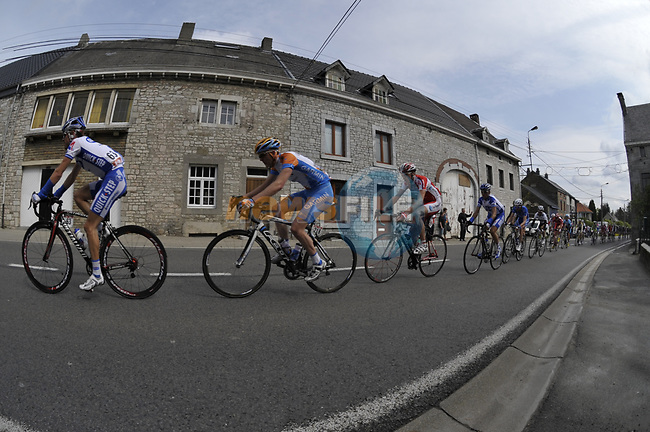 The peleton passes through the village of Awan through Awan during the 95th running of Liege-Bastogne-Liege cycle race, running 261km from Liege to Ans, Belgium. 26th April 2009 (Photo by Eoin Clarke/NEWSFILE)