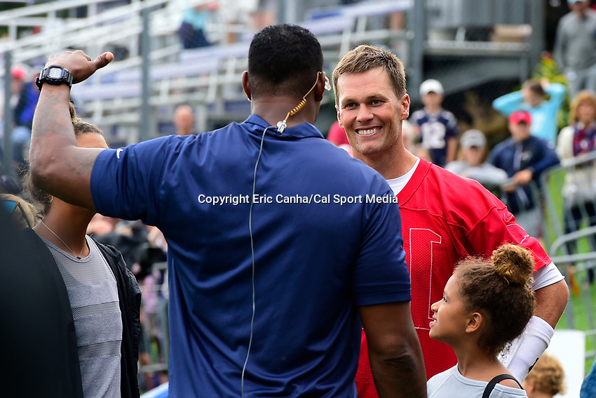 August 8, 2017: New England Patriots quarterback Tom Brady (12) talks to former Patriot Willie McGinest at the New England Patriots training camp held at Gillette Stadium, in Foxborough, Massachusetts. Eric Canha/CSM