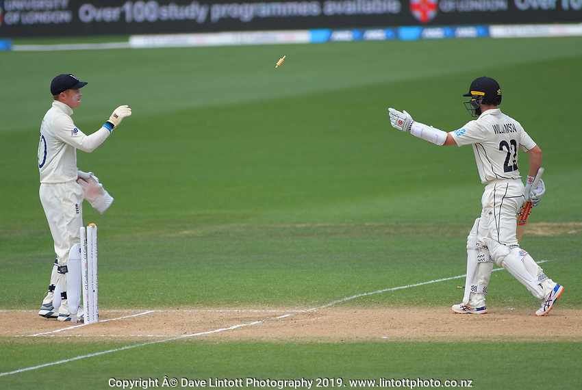 NZ captain Kane Williamson throws a bail back to England's Ollie Pope during day five of the international cricket 2nd test match between NZ Black Caps and England at Seddon Park in Hamilton, New Zealand on Tuesday, 3 December 2019. Photo: Dave Lintott / lintottphoto.co.nz