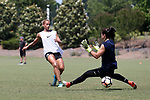 CARY, NC - MAY 10: Lynn Williams (left) slips the ball under Sabrina D'Angelo (right). The North Carolina Courage held a training session on May 10, 2017, at WakeMed Soccer Park Field 7 in Cary, NC.