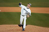Wingate Bulldogs relief pitcher Mac Callari (28) in action against the Concord Mountain Lions at Ron Christopher Stadium on February 2, 2020 in Wingate, North Carolina. The Mountain Lions defeated the Bulldogs 12-11. (Brian Westerholt/Four Seam Images)