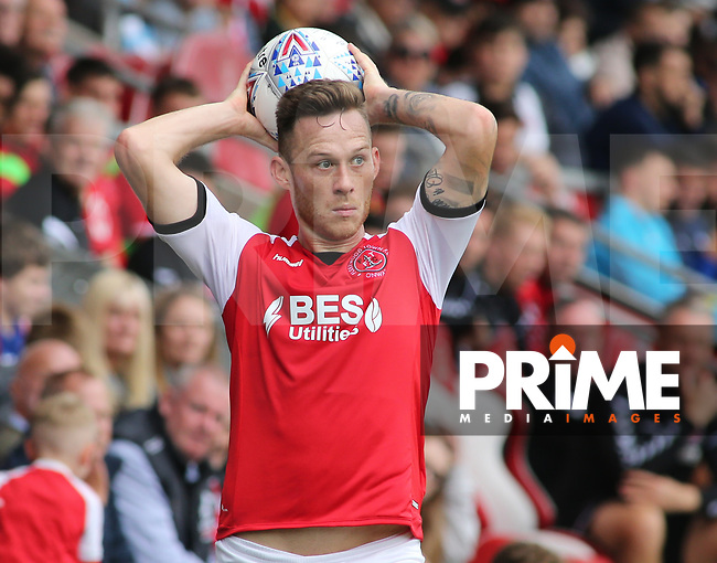 Gethin Jones of Fleetwood Town throws the ball in during the Sky Bet League 1 match between Fleetwood Town and Rochdale at Highbury Stadium, Fleetwood, England on 18 August 2018. Photo by Stephen Gaunt / PRiME Media Images.