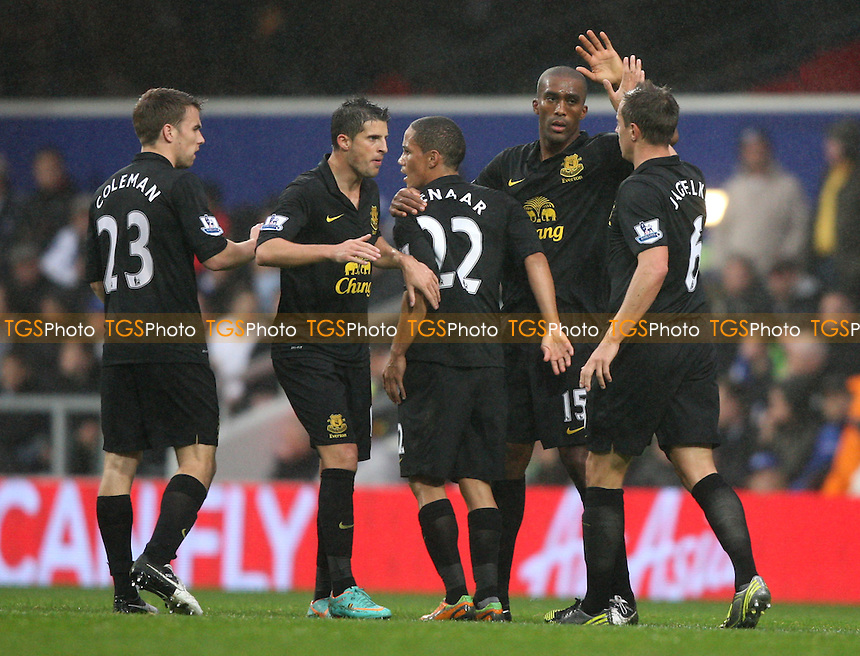 Sylvain Distin is congratulated after scoring the 1st goal for Everton - Queens Park Rangers vs Everton, Barclays Premier League at Loftus Road - 21/10/12 - MANDATORY CREDIT: Rob Newell/TGSPHOTO - Self billing applies where appropriate - 0845 094 6026 - contact@tgsphoto.co.uk - NO UNPAID USE.