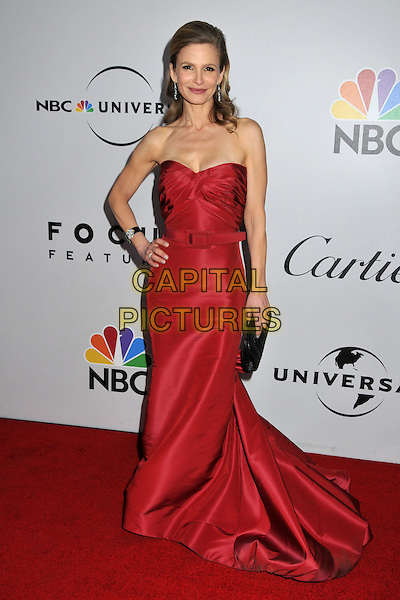 KYRA SEDGWICK.NBC Universal 66th Annual Golden Globes Post Party at the Beverly Hilton Hotel, Beverly Hills, California, USA..January 11th, 2009.full length long red strapless dress gown belt black clutch bag hand on hip.CAP/ADM/BP.©Byron Purvis/AdMedia/Capital Pictures.
