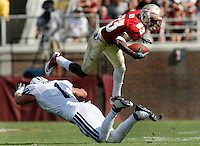 TALLAHASSEE, FL 9/18/10-FSU-BYU FB10 CH-Florida State's Bert Reed goes airborne above Brigham Young's Jordan Pendleton during first half action Saturday at Doak Campbell Stadium in Tallahassee. .COLIN HACKLEY PHOTO