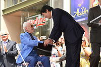Charles Aznavour &amp; Kevin de Leon at the the Hollywood Walk of Fame star ceremony honoring French singer Charles Aznavour on Hollywood Boulevard, USA 24 Aug. 2017<br /> Picture: Paul Smith/Featureflash/SilverHub 0208 004 5359 sales@silverhubmedia.com