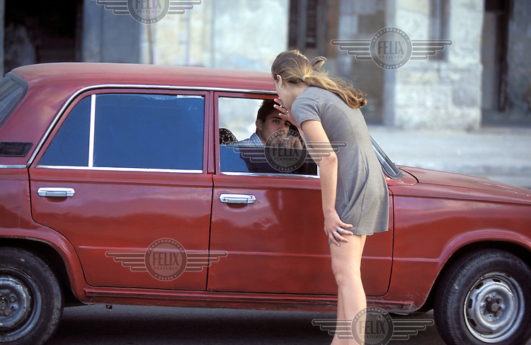 © Betty Press / Panos Pictures..Madrid, Spain...Prostitute talking to a potential client.