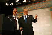Washington, D.C. - June 15, 2007 -- Esperanza president Reverend Luis Cortez introduces United States President George W. Bush before his remarks at the 2007 National Hispanic Prayer Breakfast . <br /> Credit: Chris Maddaloni - Pool via CNP