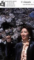 Ms. Reiko Yunoki, administrative assistant of the Corus Aluminium Japan, poses in Tokyo, Japan.<br />31-MAR-03