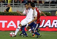 PASADENA - UNITED STATES, 07-06-2016: Carlos Bacca (C) jugador de Colombia (COL) disputa el balón con Miguel Samudio (Izq) y Gustavo Gomez (Der) jugador de Paraguay (PAR) durante partido del grupo A fecha 2 por la Copa América Centenario USA 2016 jugado en el estadio Rose Bowl en Pasadena, California, USA. /  Carlos Bacca  (C) player of Colombia (COL) fights the ball with Miguel Samudio (L) and Gustavo Gomez (R) player of Paraguay (PAR) during match of the group A date 2 for the Copa América Centenario USA 2016 played at Rose Bowl stadium in Pasadena, California, USA. Photo: VizzorImage/ Luis Alvarez /Str
