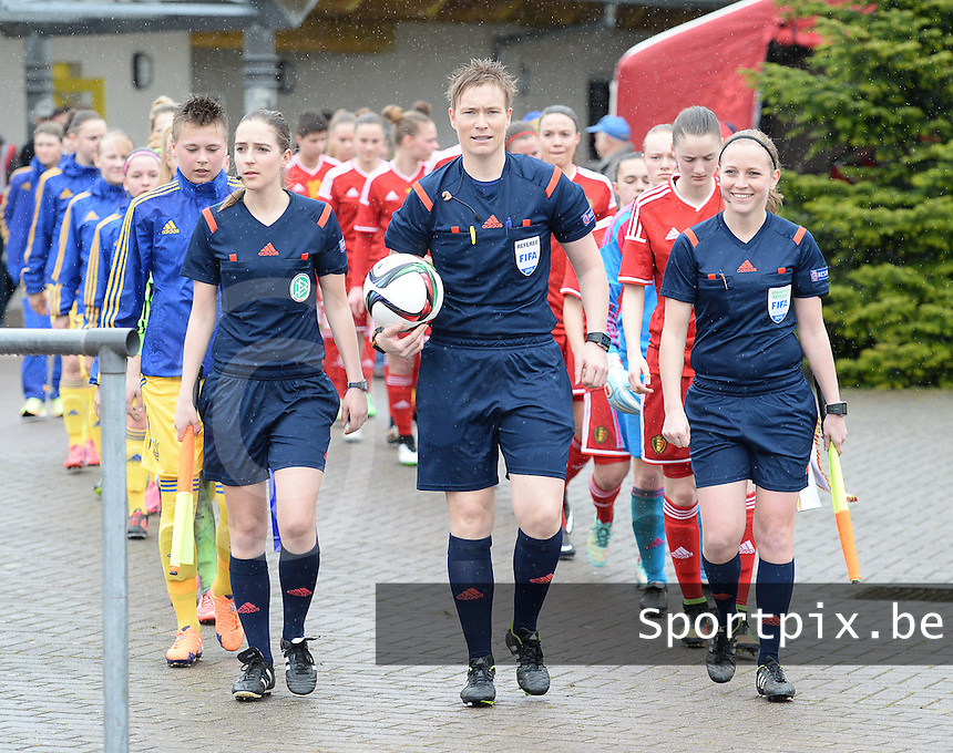 20150404 - FORST , GERMANY  : referees pictured with German Imke Lohmeyer (left) , Norwegian Marte Soro (middle) and Norwegian Linda Andresen (right) during the soccer match between Women Under 19 teams of Belgium and Ukraine , on the first matchday in group 5 of the UEFA Elite Round Women Under 19 at WaldseeStadion , Forst , Germany . Saturday 4th April 2015 . PHOTO DAVID CATRY