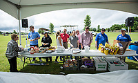 NWA Democrat-Gazette/BEN GOFF @NWABENGOFF<br /> Volunteers serve guests Friday, June 7, 2019, during the Rogers-Lowell Area Chamber of Commerce annual picnic at Ward Nail Park in Lowell. The park plays host to Lowell's annual Mudtown Days opening Friday evening and continuing from 10:30 a.m. to 10:00 p.m. Saturday with a wide variety of concerts and family activities.