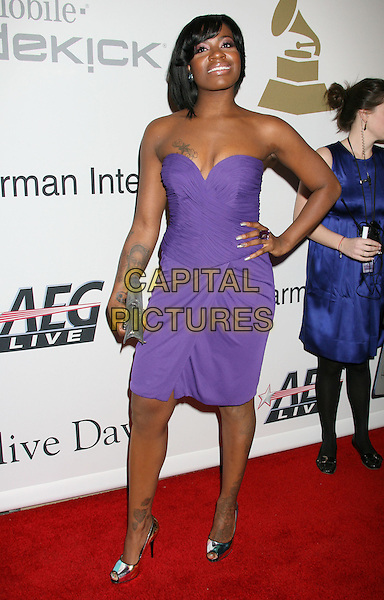 FANTASIA BARRINO.51st Annual GRAMMY Awards - Salute To Icons: Clive Davis Pre-Grammy Gala held at the Beverly Hilton Hotel, Beverly Hills, California, USA..February 7th, 2009.full length purple strapless dress hand on hip clutch bag tattoos grey gray.CAP/ADM/MJ.©Michael Jade/AdMedia/Capital Pictures.