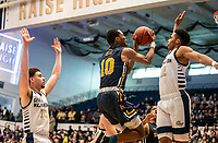 WASHINGTON, DC - FEBRUARY 22: Isiah Deas #10 of La Salle goes up for a shot defended by Jameer Nelson Jr. #12 of George Washington during a game between La Salle and George Washington at Charles E Smith Center on February 22, 2020 in Washington, DC.