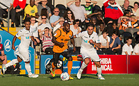 Jamal Campbell-Ryce of Barnet takes on Angel Rangel (right) of Swansea City during the 2017/18 Pre Season Friendly match between Barnet and Swansea City at The Hive, London, England on 12 July 2017. Photo by Andy Rowland.