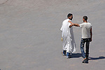 Two men greet each other on the street in Marrakesh, Morocco.